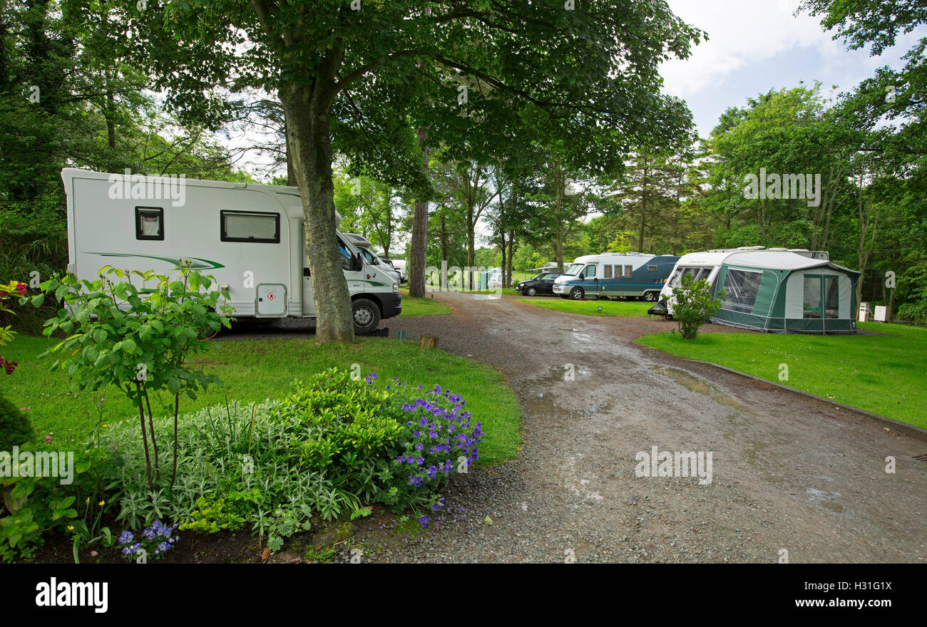 Mobile Home Motorhome Caravans Among Shading Trees Verdant Lawns And Colourful Gardens At Ravenglass Caravan Park Cumbria England