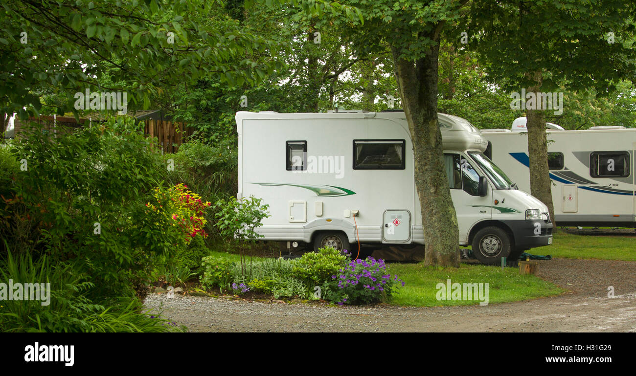 Modern Motorhome Mobile Home Among Shading Trees Verdant Lawns And Colourful Gardens At Ravenglass Caravan Park Cumbria England