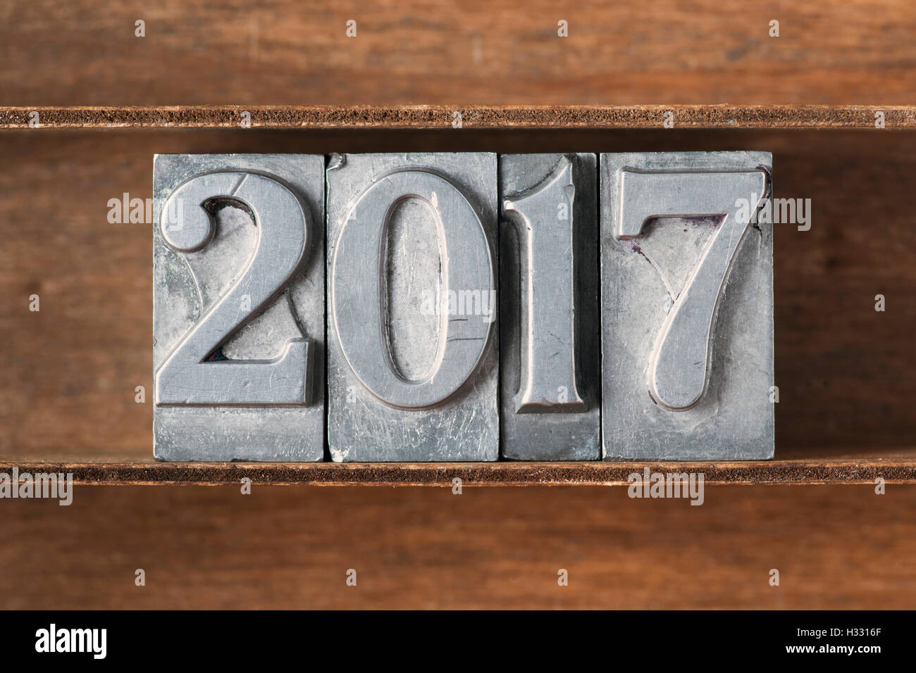 2017 number made from metallic letterpress type on wooden tray