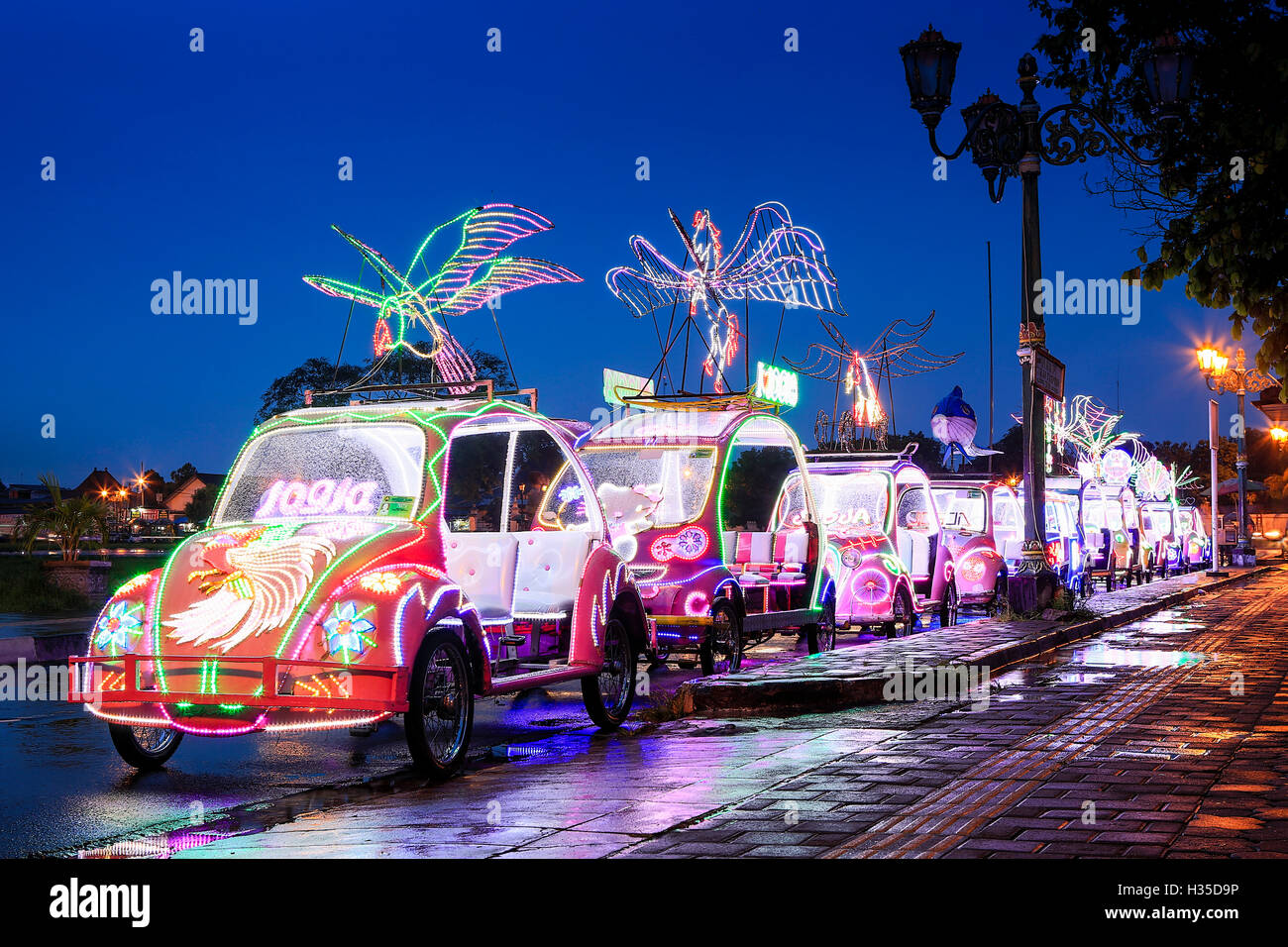 Brightly coloured illuminated pedal cars in yogyakarta city java brightly coloured illuminated pedal cars in yogyakarta city java indonesia stopboris Choice Image