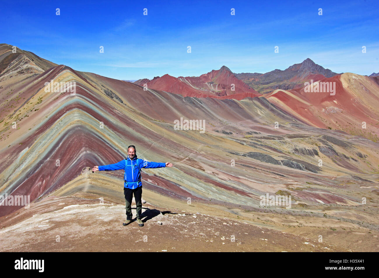 Mountain living near cusco peru royalty free stock photo - Stock Photo The Photographer Posing In Front Of The Beautiful Colored Rainbow Mountain Panorama Near Cusco Peru Nice View Into The Hole Val