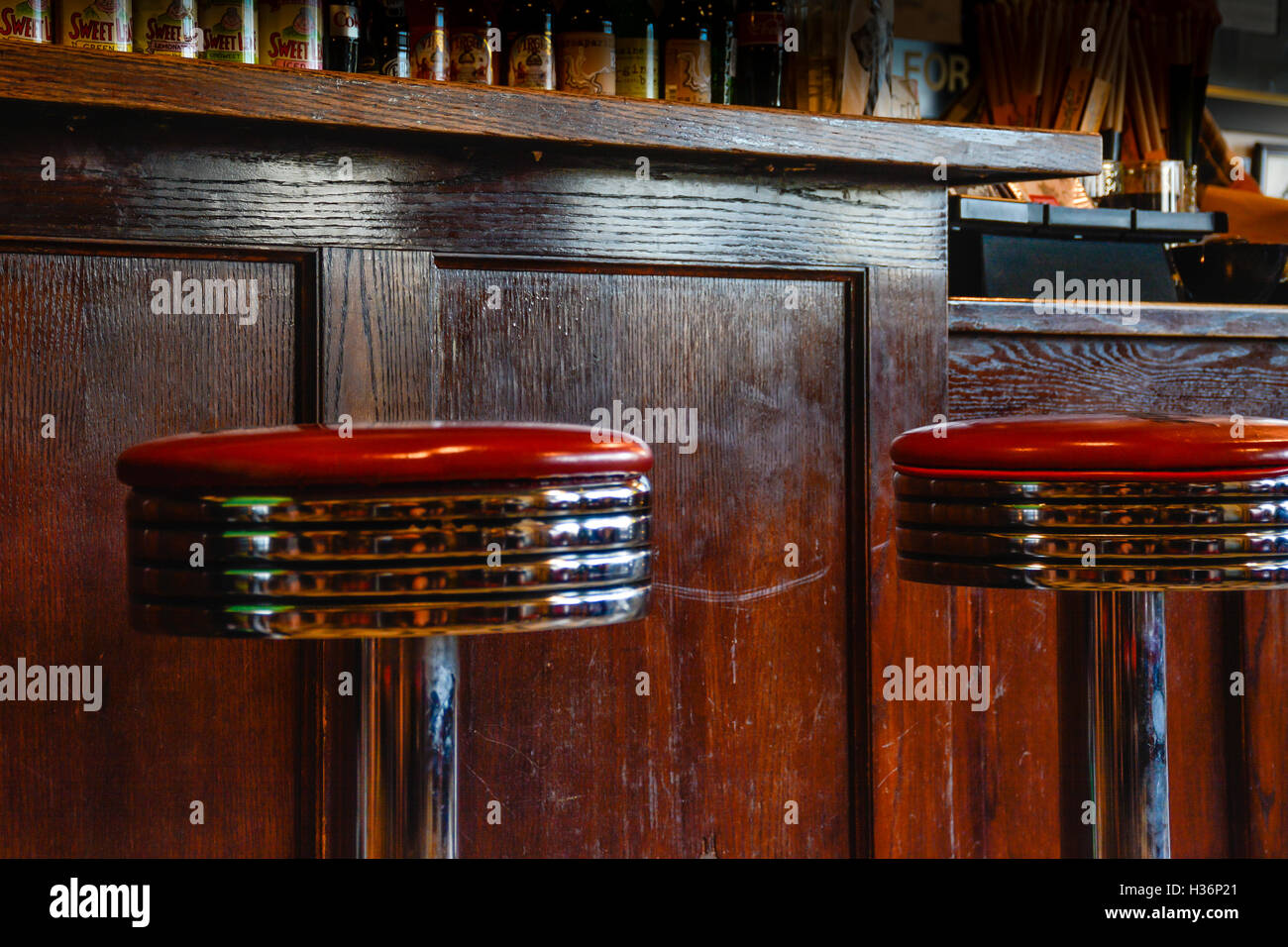 Interior retro bar stools of chrome and red leather against vintage wooden bar area & Interior retro bar stools of chrome and red leather against ... islam-shia.org