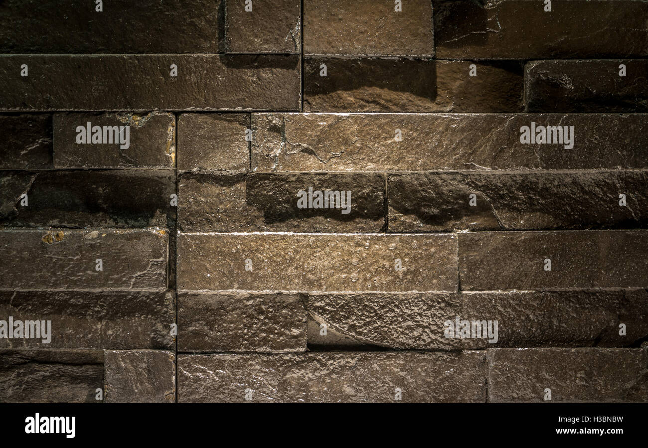 modern brick wall pattern of black slate wall texture and stock