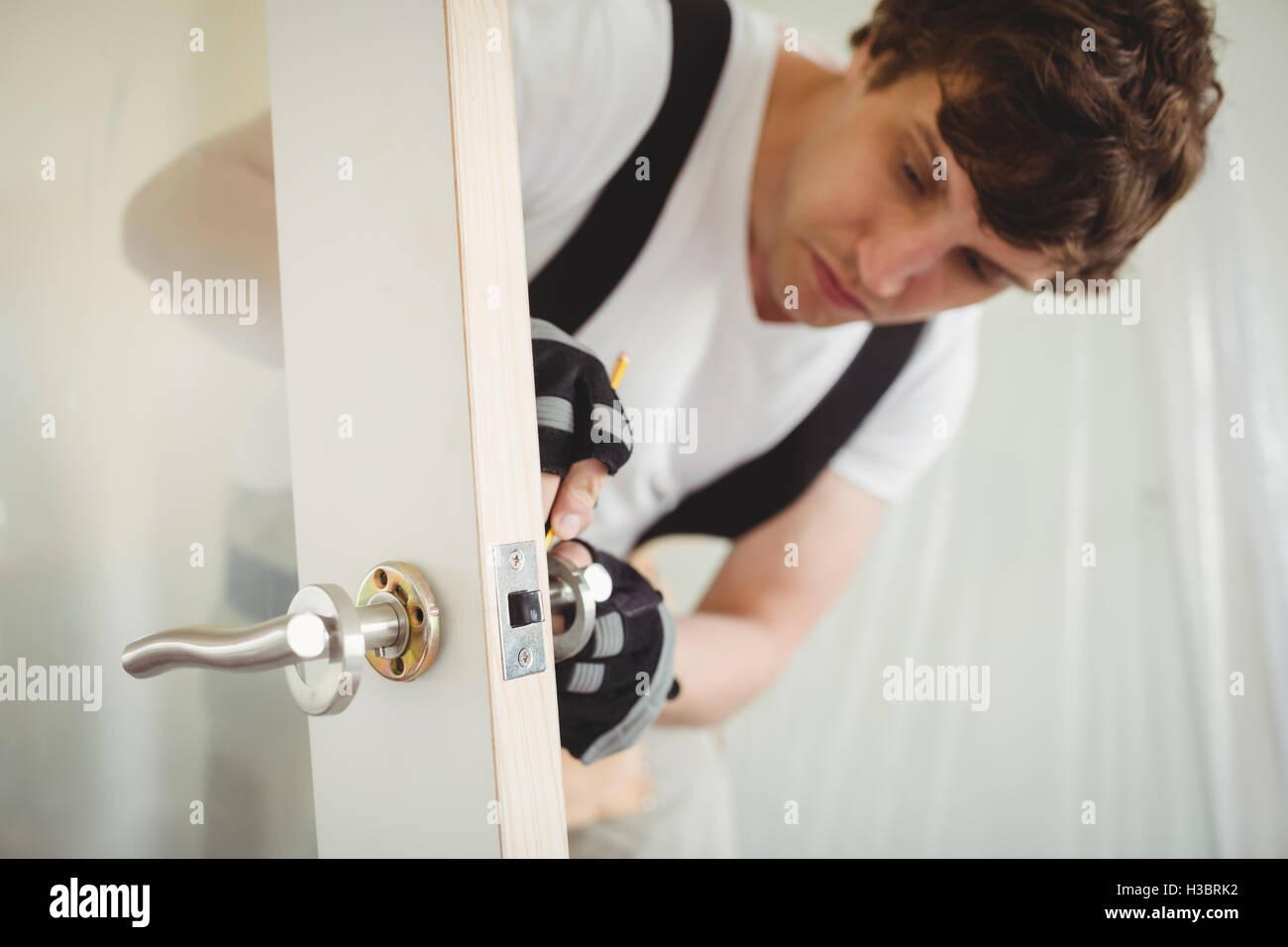 Carpenter Fixing Door Lock