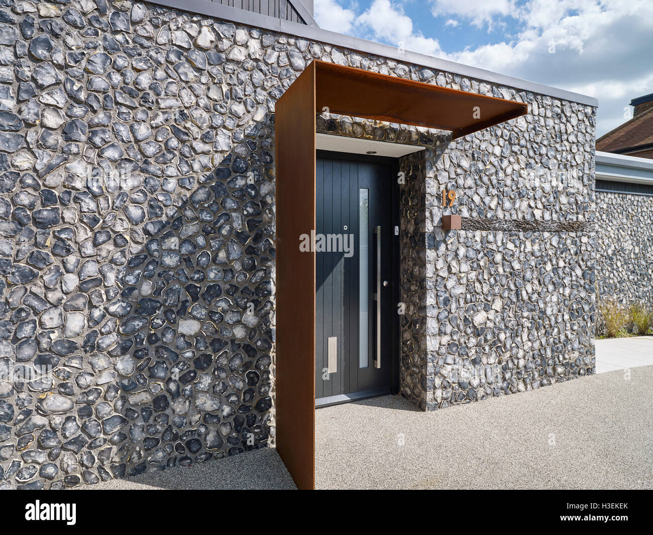 Front Elevation With Flint And Rusted Corten Steel. House 19