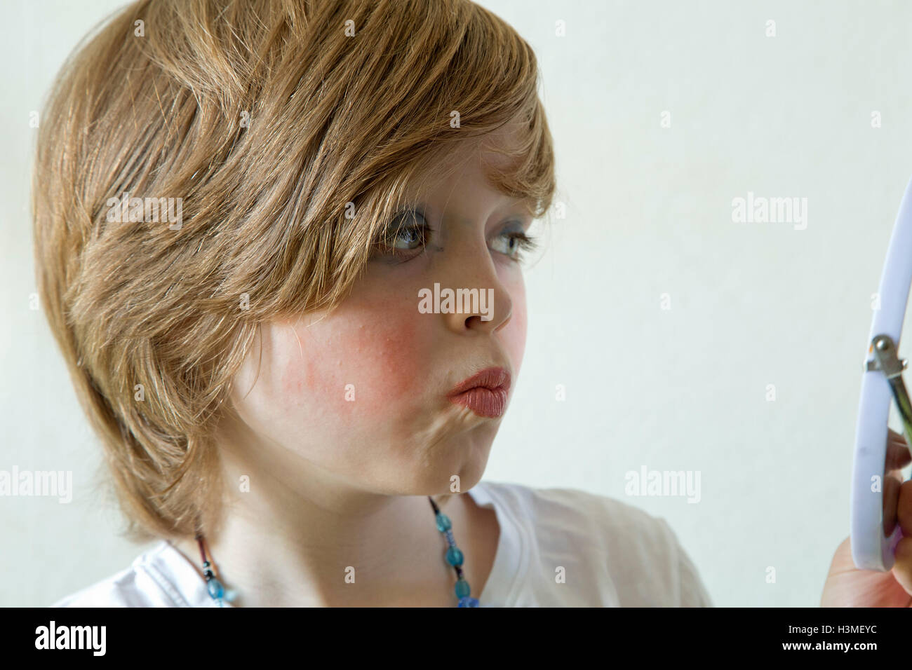 Young Boy Putting Makeup On Pretending To Be A Girl Stock Photo Royalty Free Image 122767328 ...