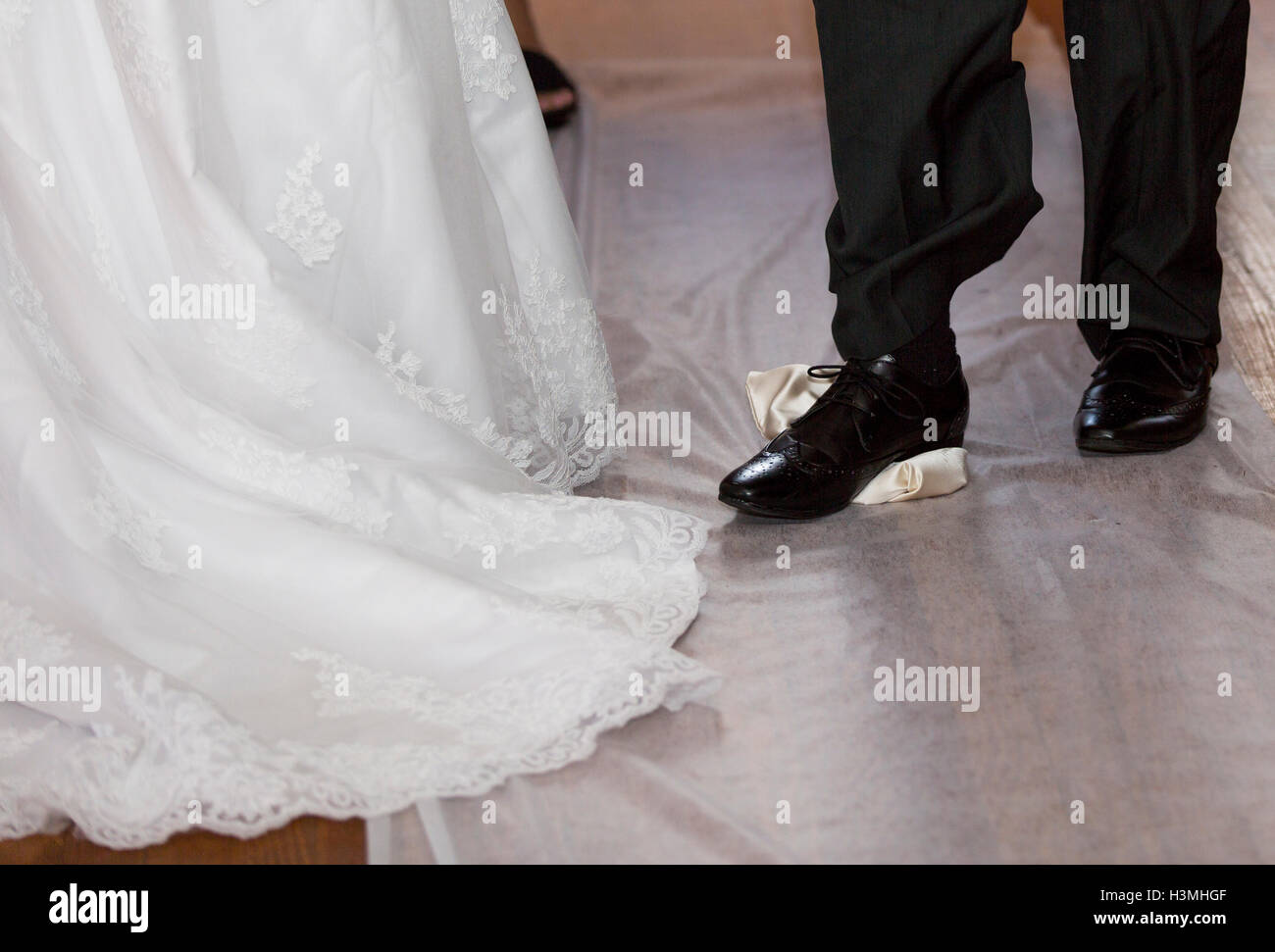 Groom breaking a glass at jewish wedding stamping it underfoot symbolising the destruction of - Breakable wedding glass ...