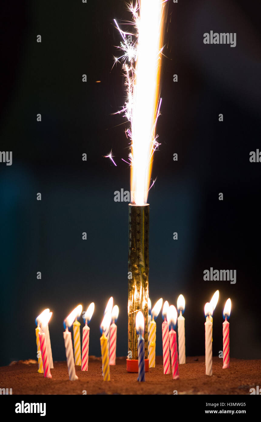 Chocolate birthday cake with 18 candles and a firework sparkler