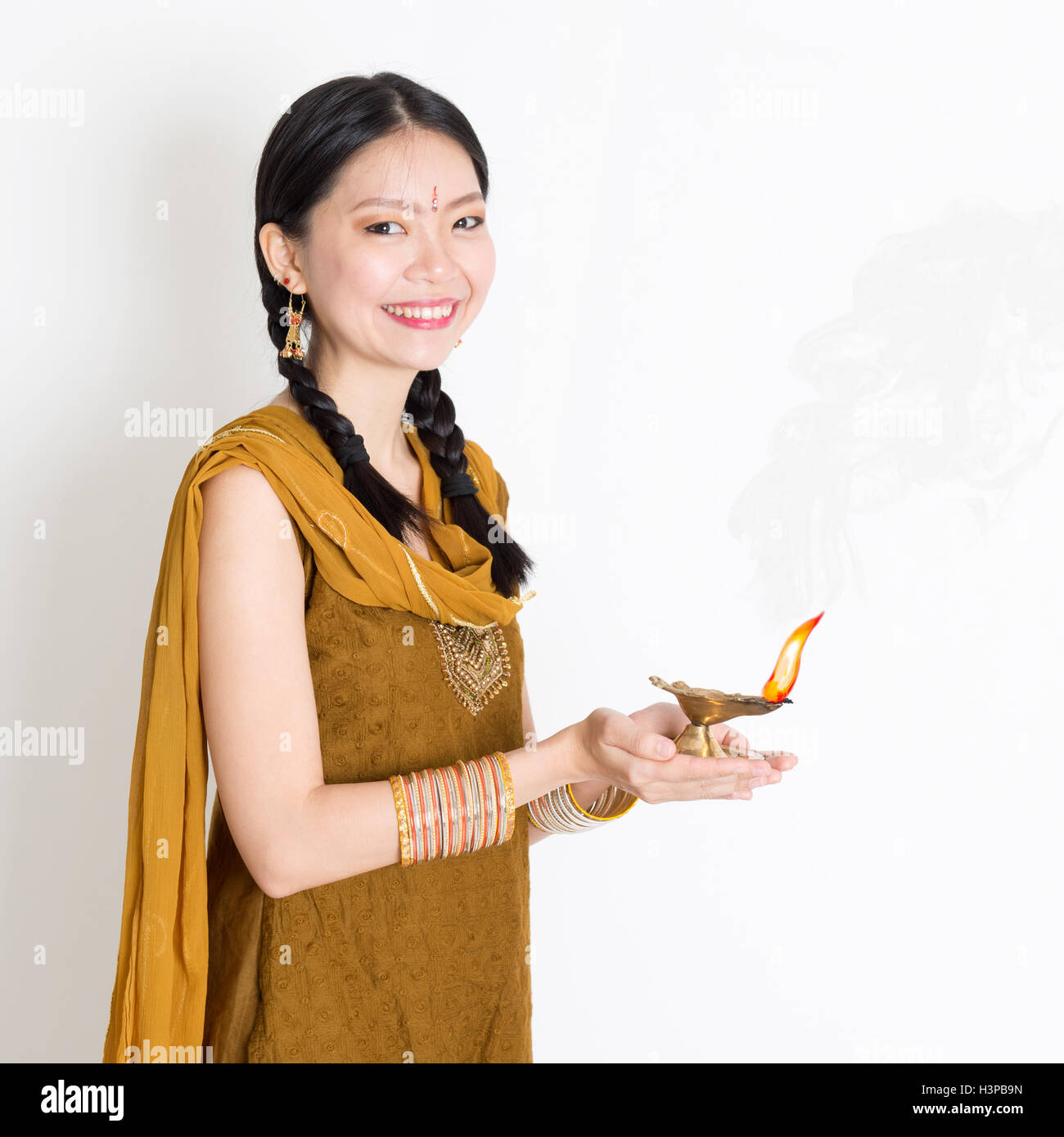 Mixed race Indian Chinese girl in traditional dress hands holding ... for Girl Holding Lamp  61obs