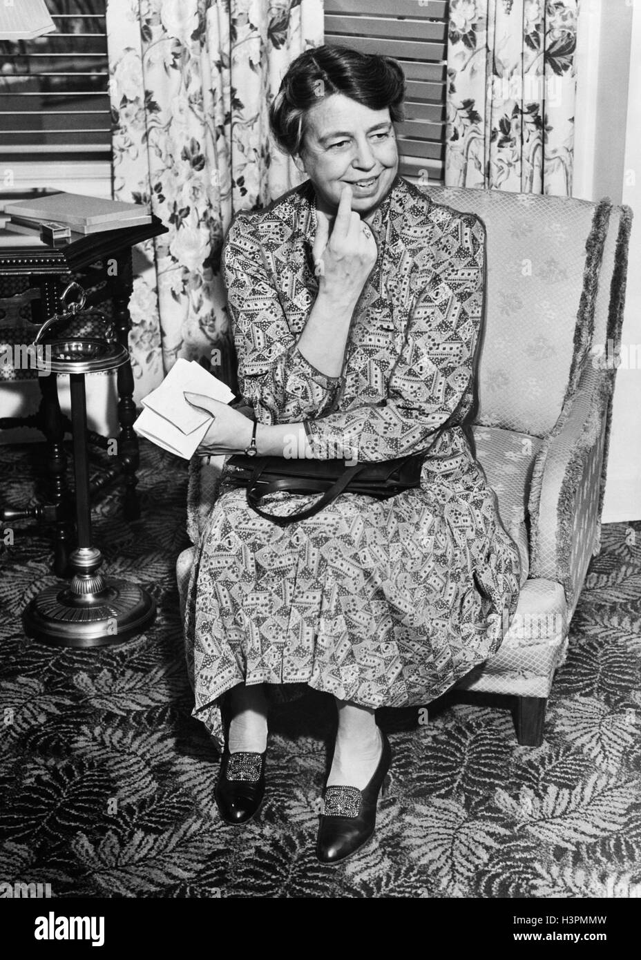 1940s 1941 SMILING FIRST LADY ELEANOR ROOSEVELT SITTING IN ARMCHAIR