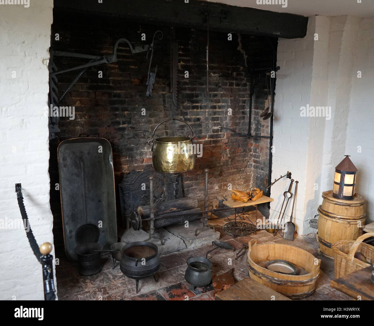 elizabethan kitchen with fireplace and pots stock photo royalty
