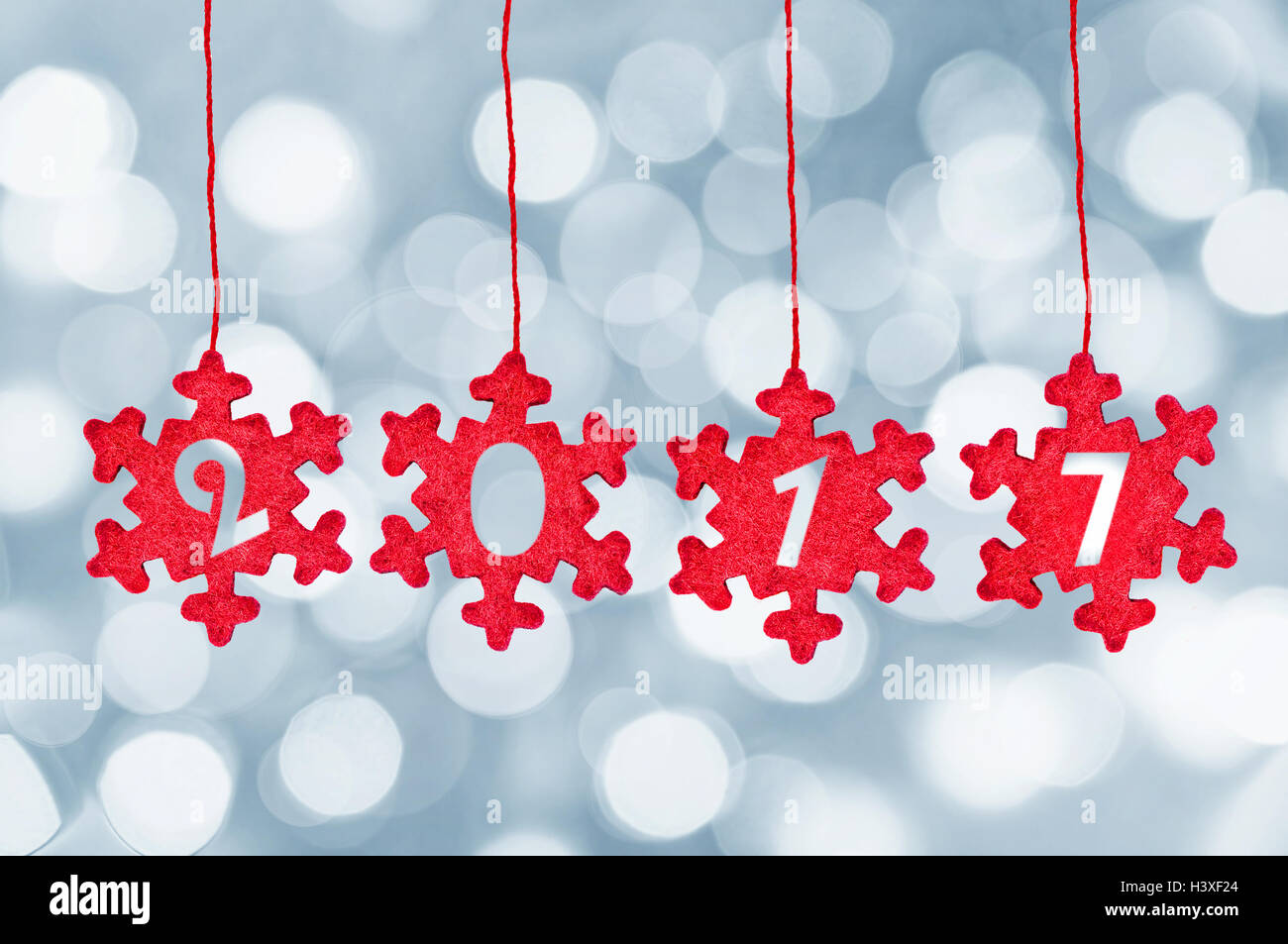 2017 cut in red fabric christmas ornaments hanging on bokeh Stock ...