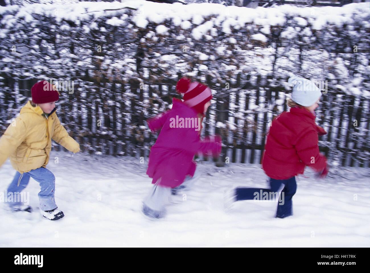 girls winter clothes snow run side view garden fence blur