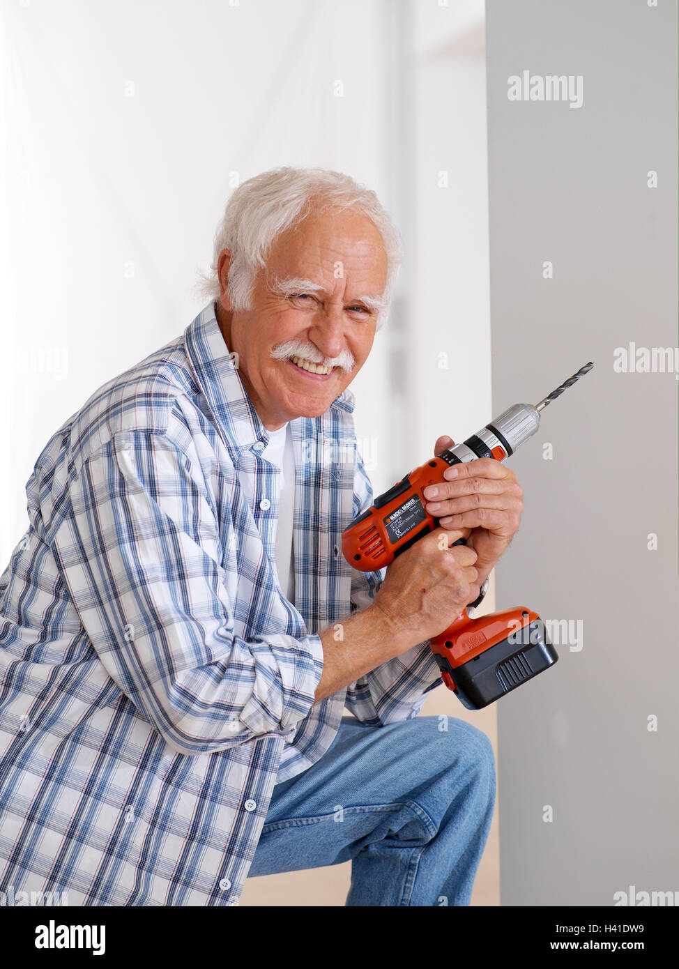 Flat renovation works senior drill smile renovate detail 60 flat renovation works senior drill smile renovate detail 60 70 years man pensioner do it yourselfer actively fit agile old person solutioingenieria Gallery