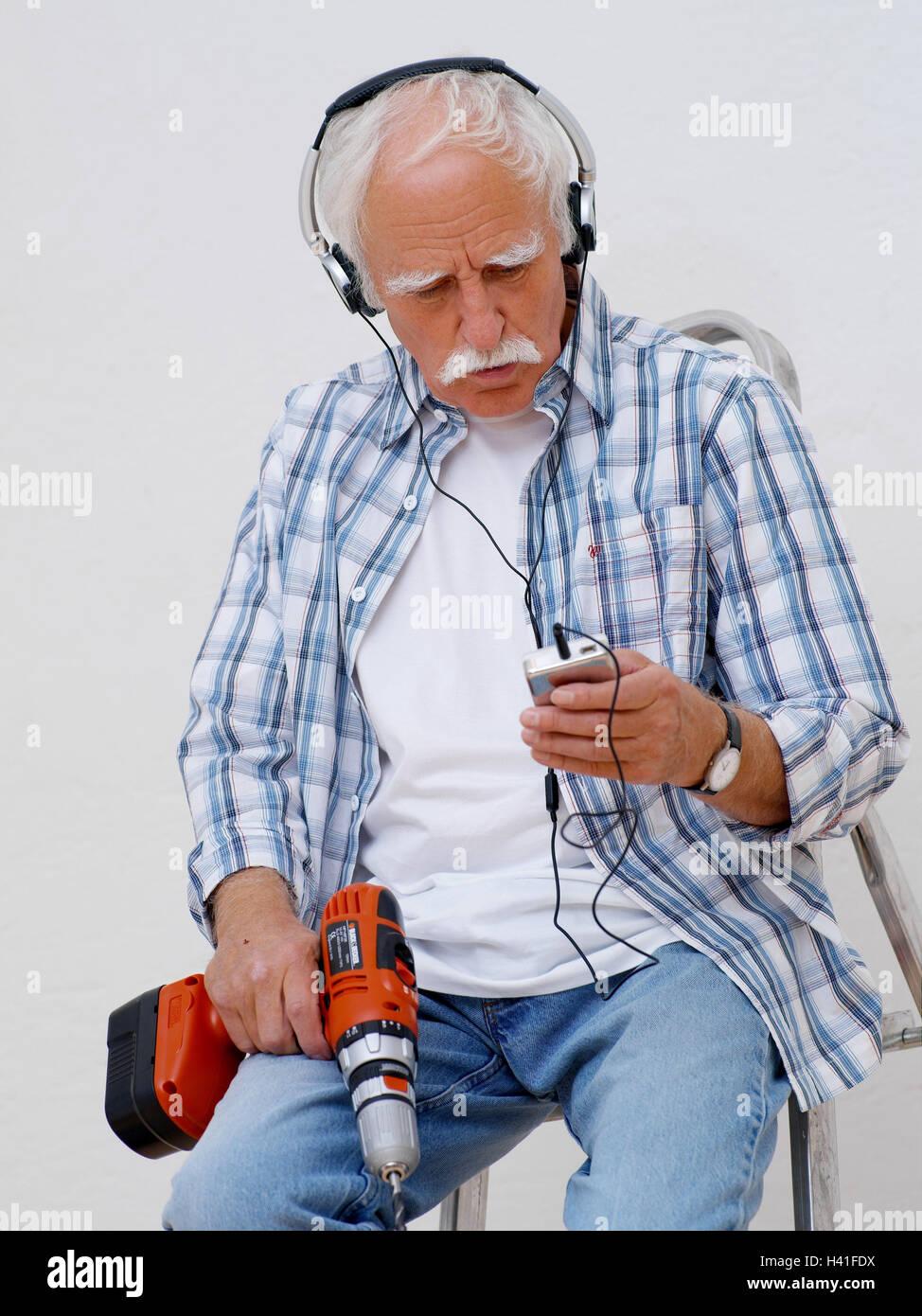 Renovation works senior drill earphone music hear 60 70 years renovation works senior drill earphone music hear 60 70 years man do it yourselfer do it yourself renovate battery drills rest relax break solutioingenieria Gallery