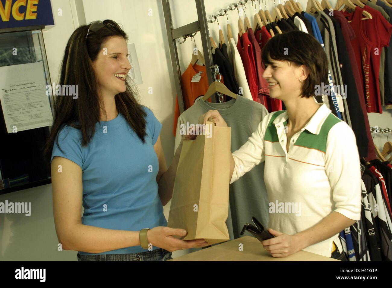 w shopping tour shop assistant product paper bag pass stock photo w shopping tour shop assistant product paper bag pass leisure time young 20 30 years boutique clothing business fashion house