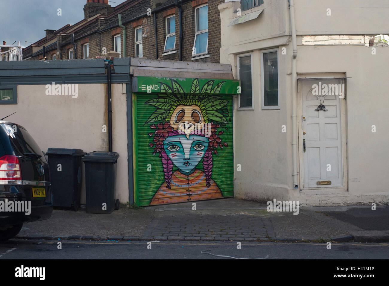 art on a garage shutter door in leyton east london stock photo art on a garage shutter door in leyton east london