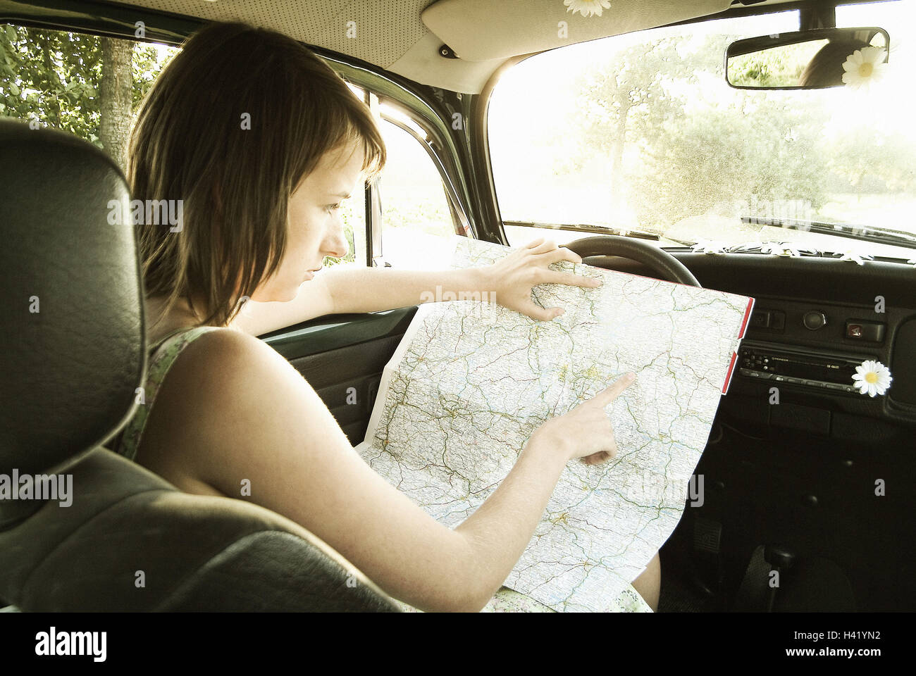 Car woman young drifting map read 2030 years darkhaired