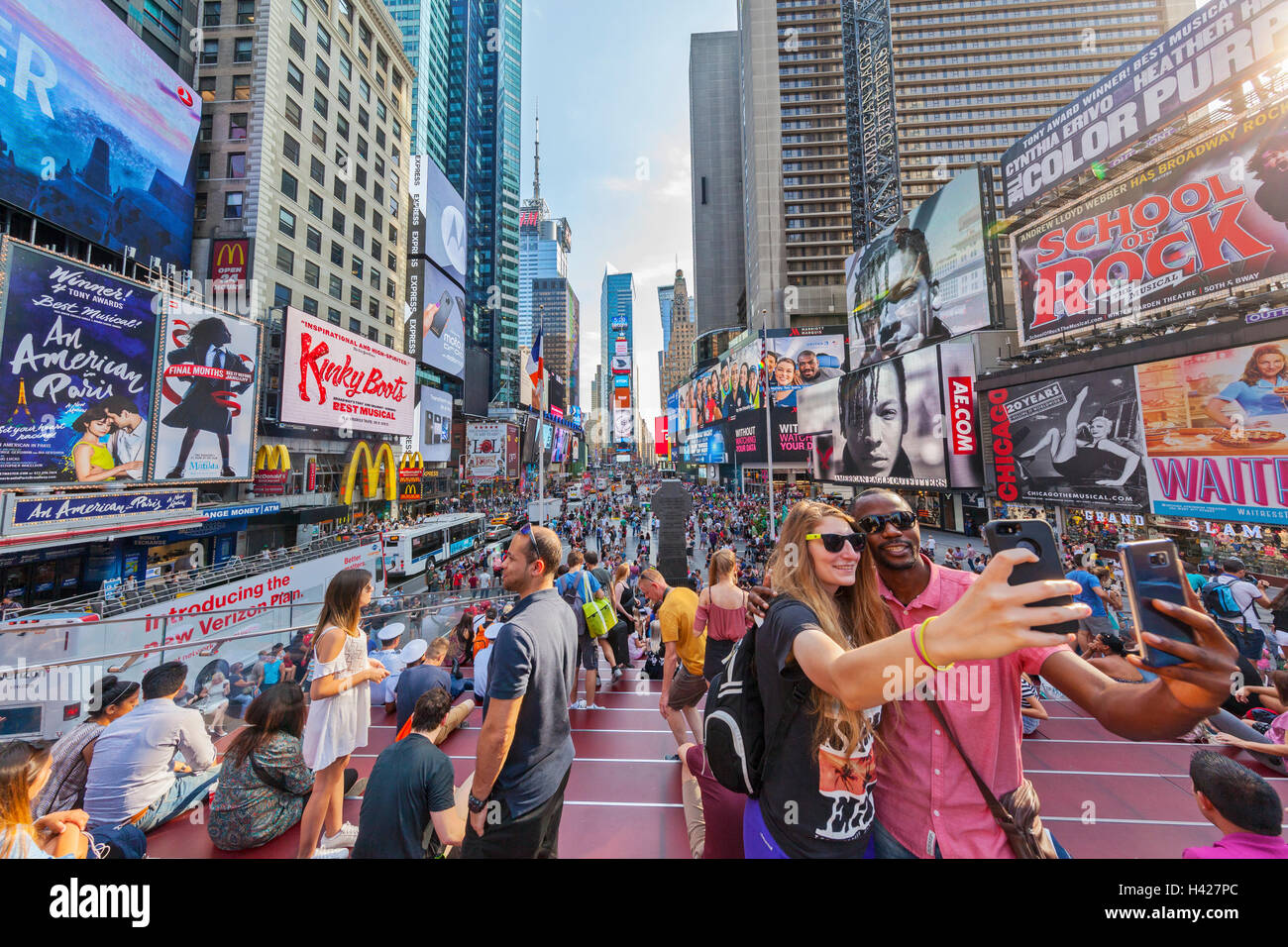 tourists taking selfies in times square new york city new york stock photo royalty free image. Black Bedroom Furniture Sets. Home Design Ideas