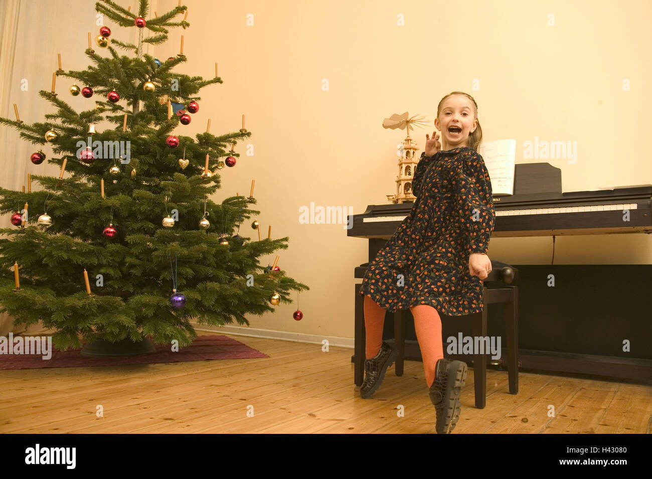 Musical christmas ornaments that play music -  Christmas Eve For Christmas Christmas Tree Child 8 Years Blond Musical Instrument Music To Piano Playings Make Music Play Showing Musically