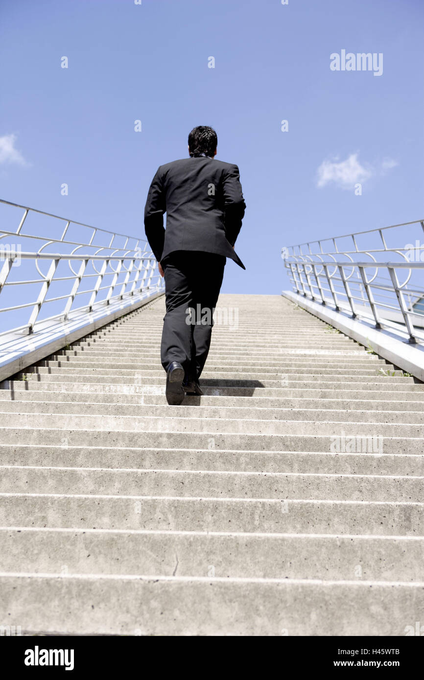 stairs businessman young suit black promotion back view stairs businessman young suit black promotion back view business conception success future steps banisters purposefully career man person