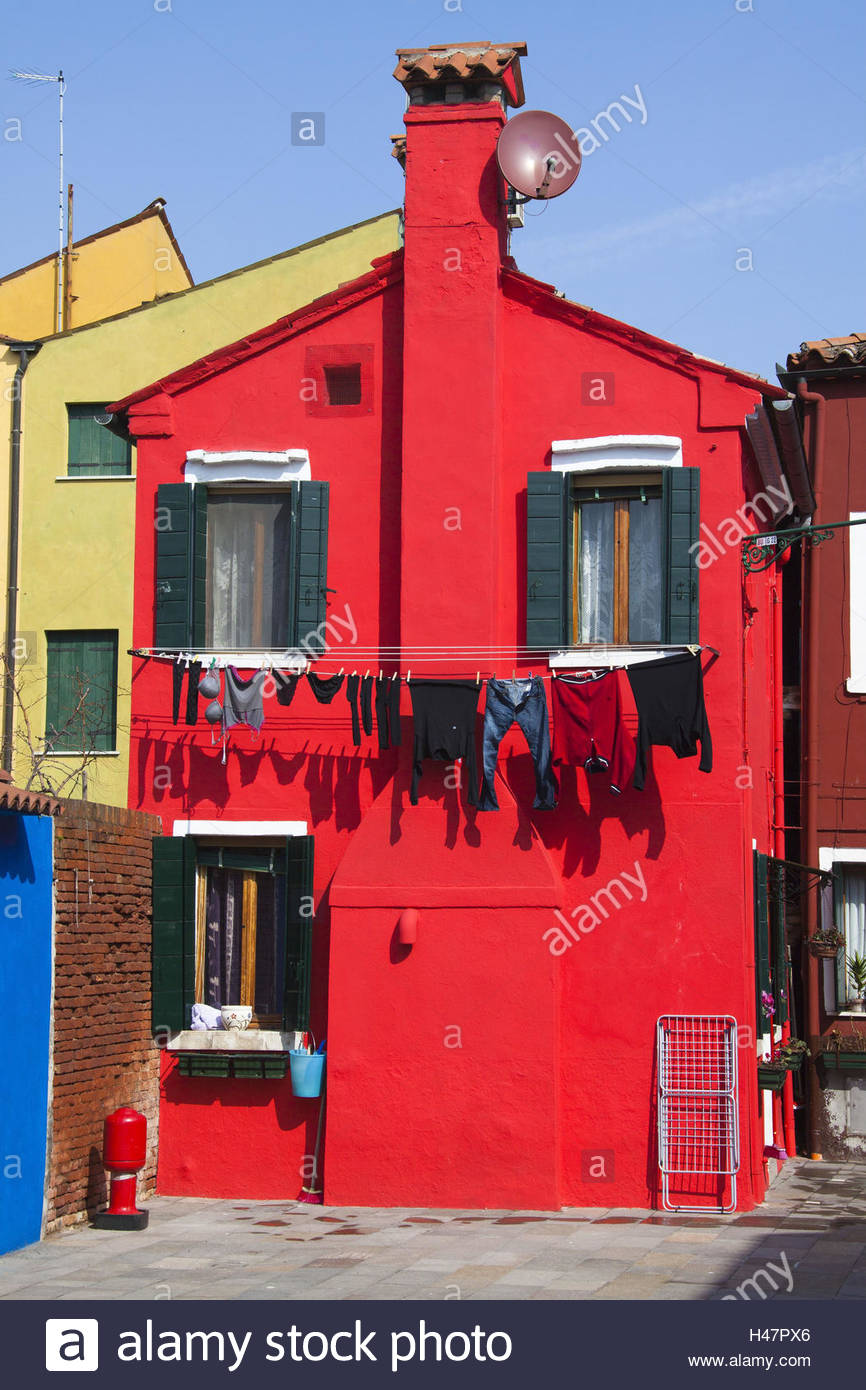 Laundry Hanging Out To Dry At A Red Painted House In The Alleys On The  Island Burano,