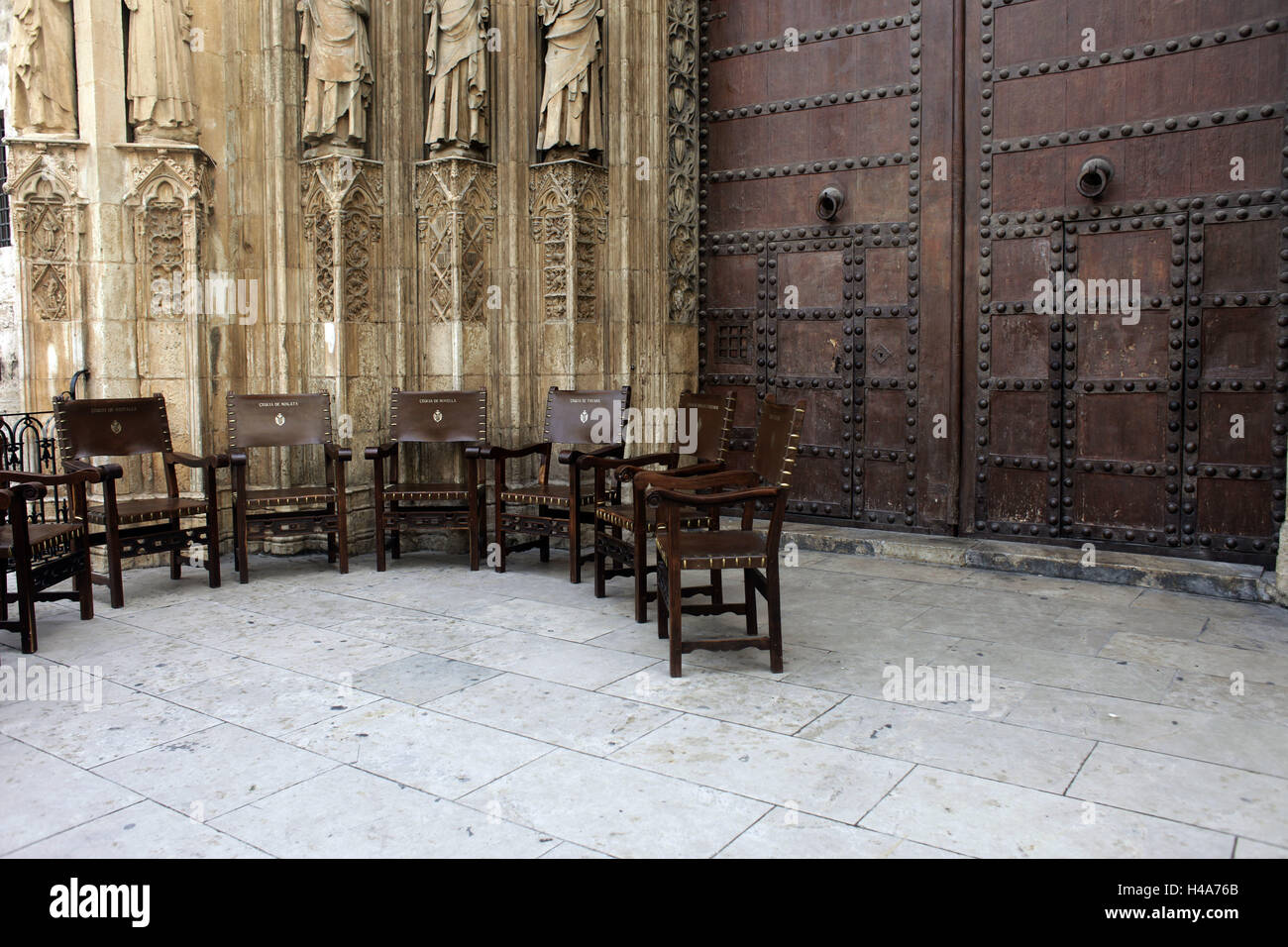spain valencia cathedral inside no people church chairs wooden chairs door closed