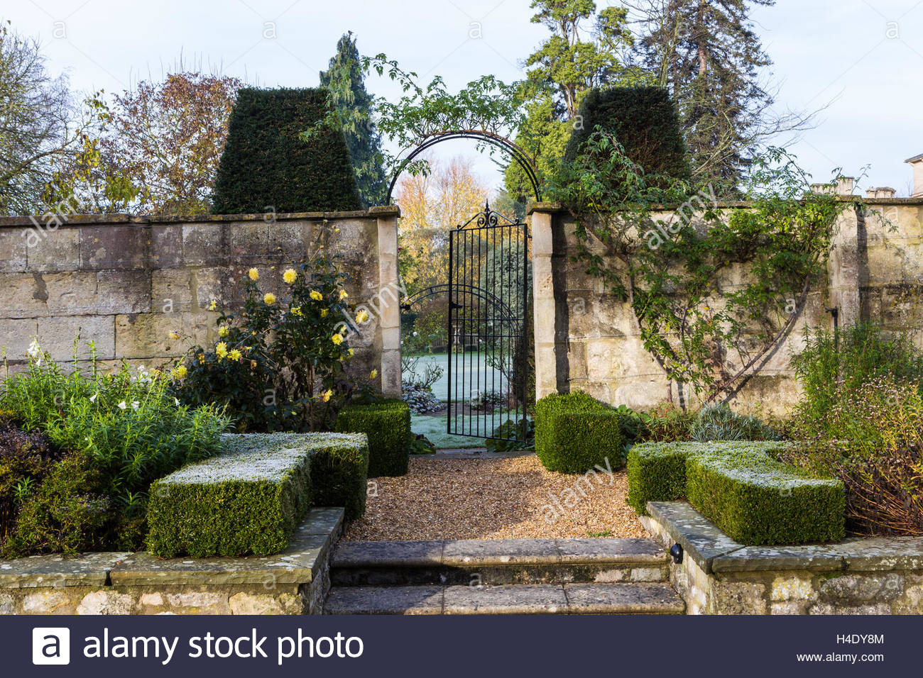 beautiful elegant gateway in frosty winter garden at the priory