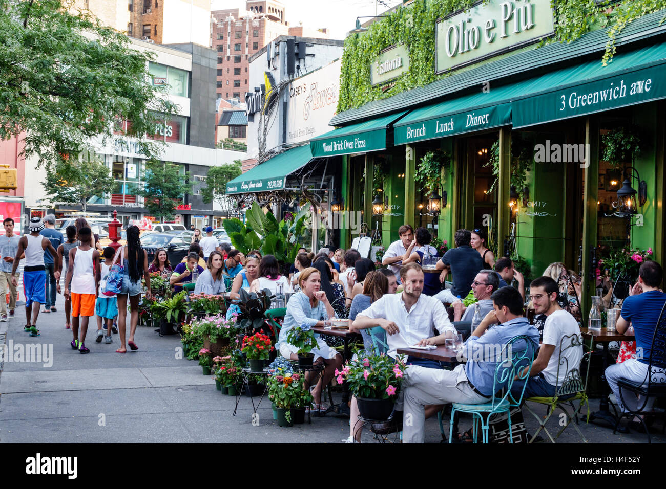Manhattan New York City NYC NY West Village Olio E Piu Italian Restaurant  Trattoria Sidewalk Alfresco Dining Brunch Man Woman Couple Tables Outdoor Se