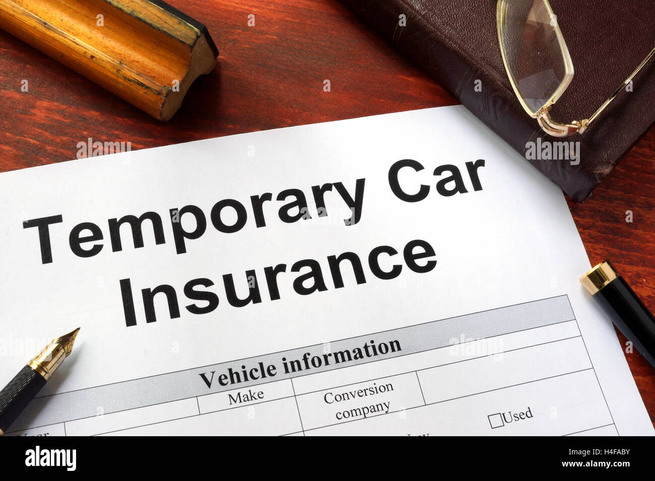 Temporary Car Insurance Application Form On A Table Stock Photo