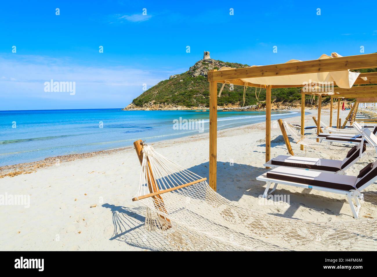 hammocks with sunchairs on white sand beach in porto giunco bay sardinia island italy hammocks with sunchairs on white sand beach in porto giunco bay      rh   alamy