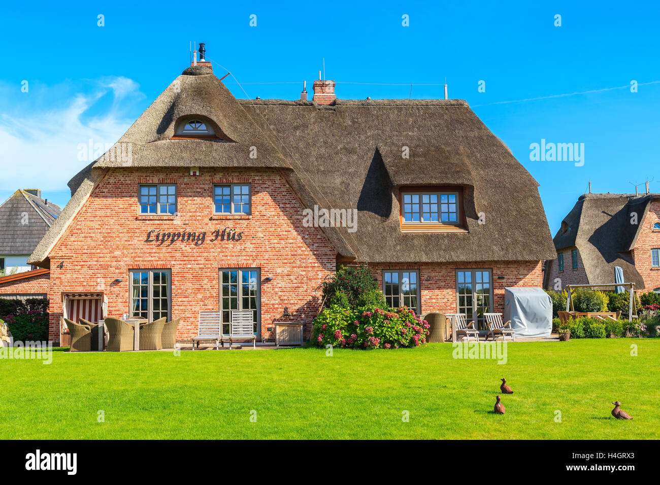 Sylt island germany sep 11 2016 traditional house with thatched stock photo royalty free - Traditional houses attic ...