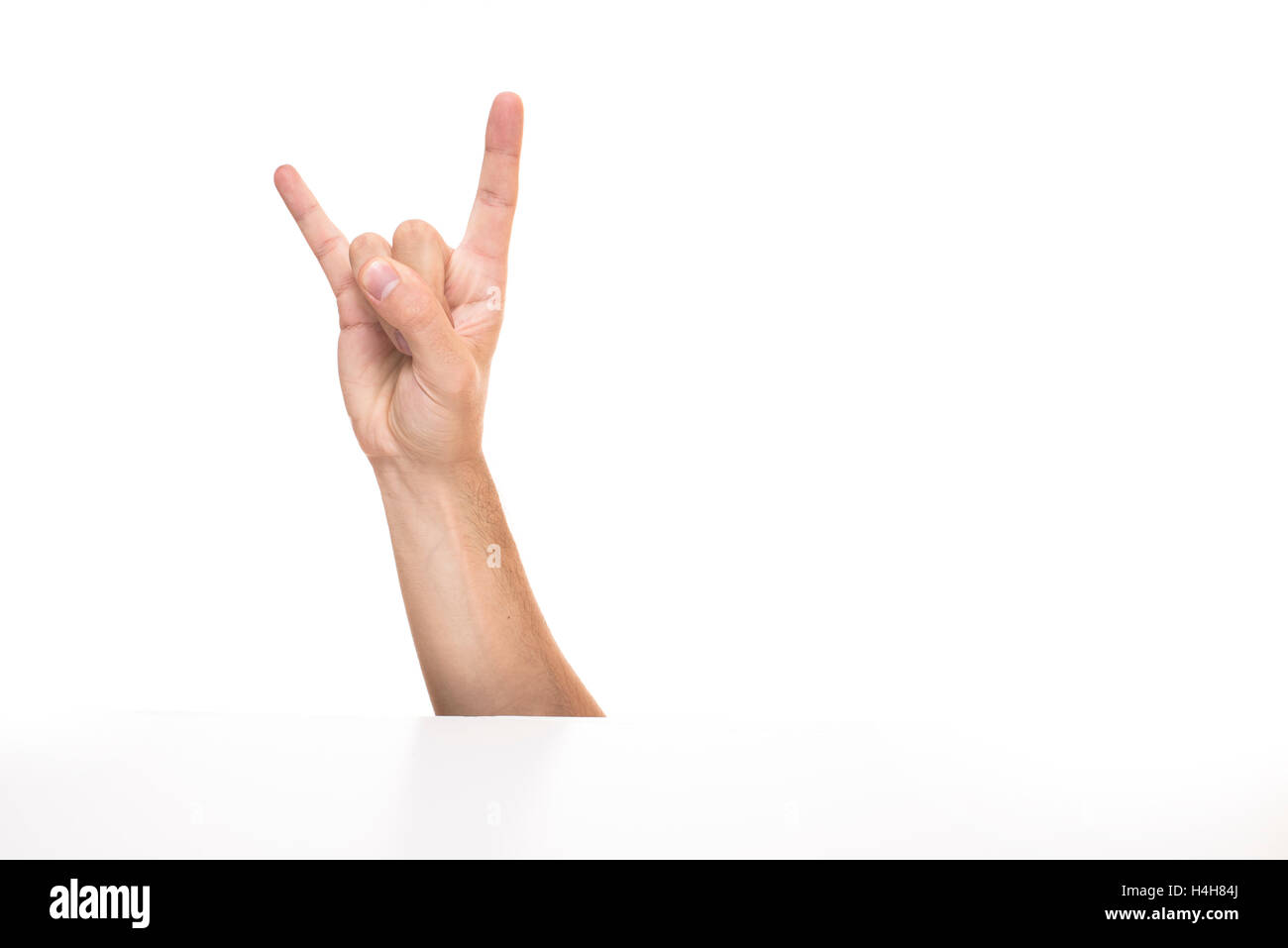 Hand shows devil horns gesture isolated on white background hand shows devil horns gesture isolated on white background rocker sign biocorpaavc Gallery