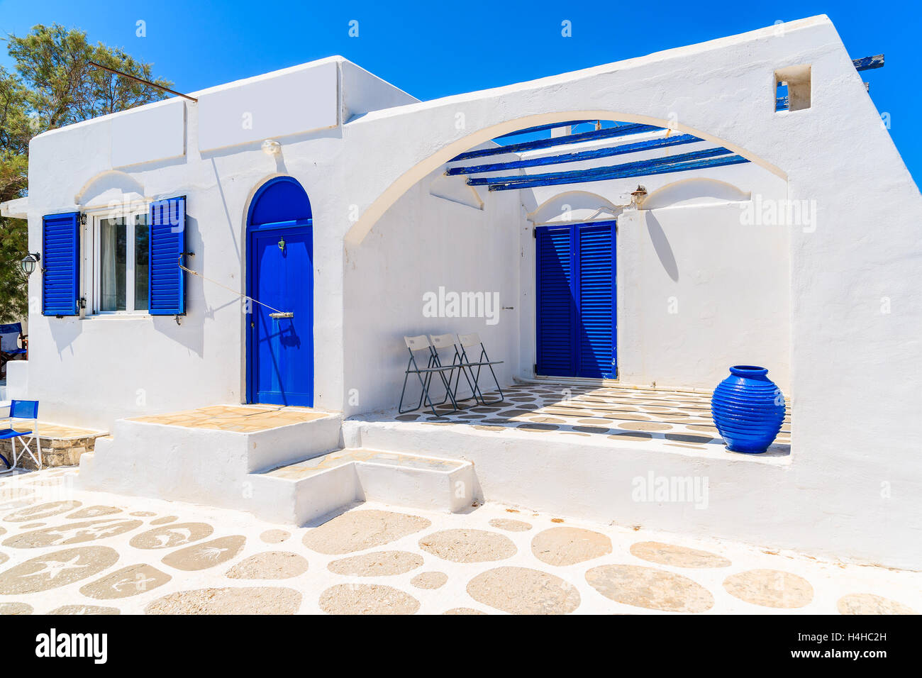 Typical white greek house with blue doors and windows in for Blue and white house