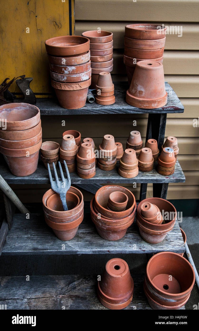 Vintage Terracotta Pots And A Vintage Garden Fork On A Gardening Bench