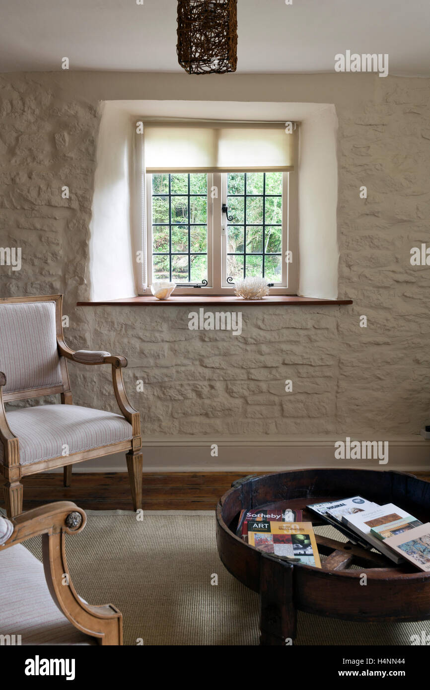 painted stone wallA contemporary furnished cottage living room with a painted stone