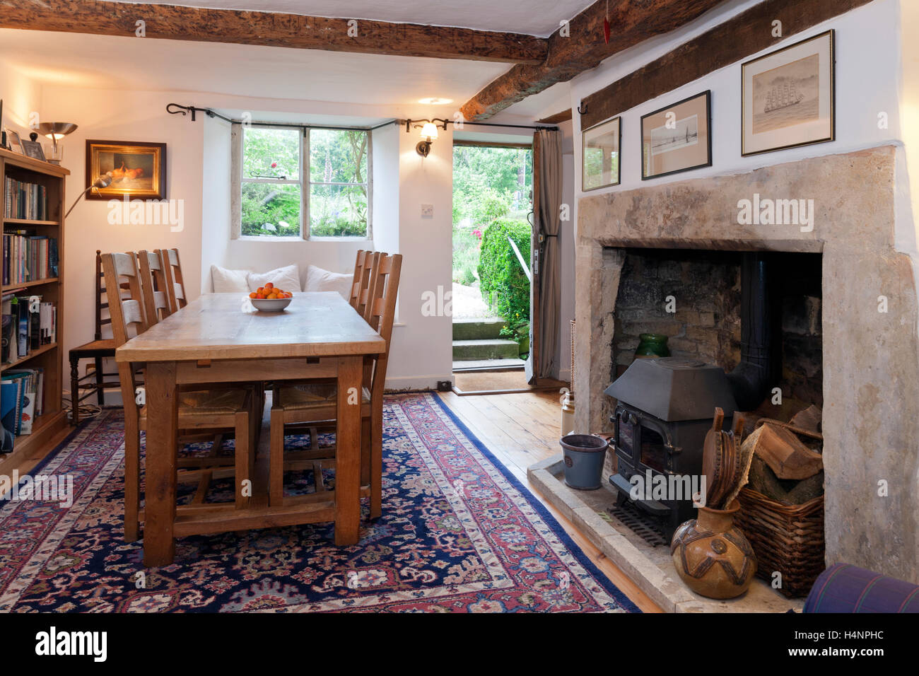 A large dining table and chairs in a small period cottage for Small front room