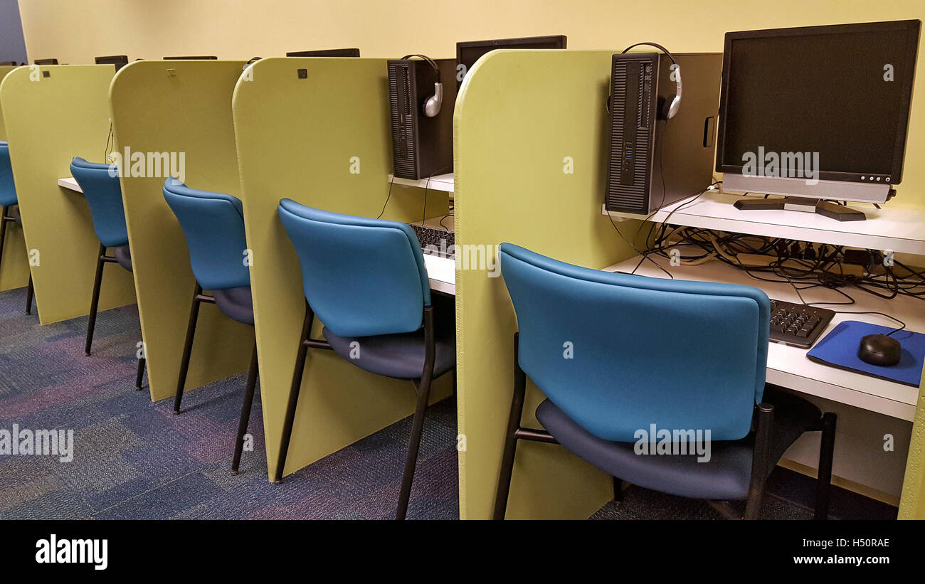 row of cubicles with computers in school classroom stock image