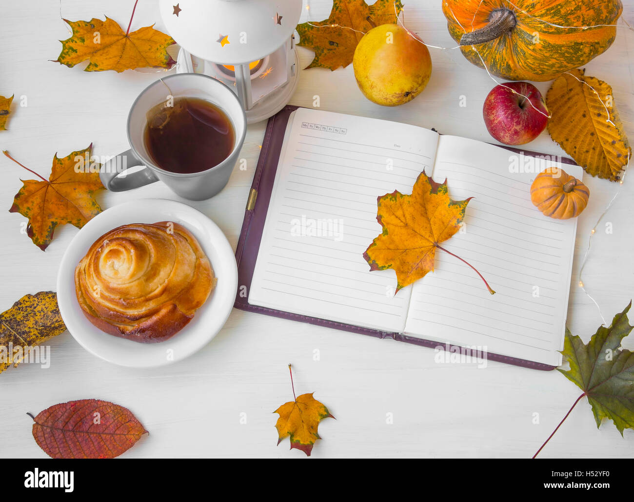 Autumn dried leaves with notebook,candle, pumpkin decoration and ...