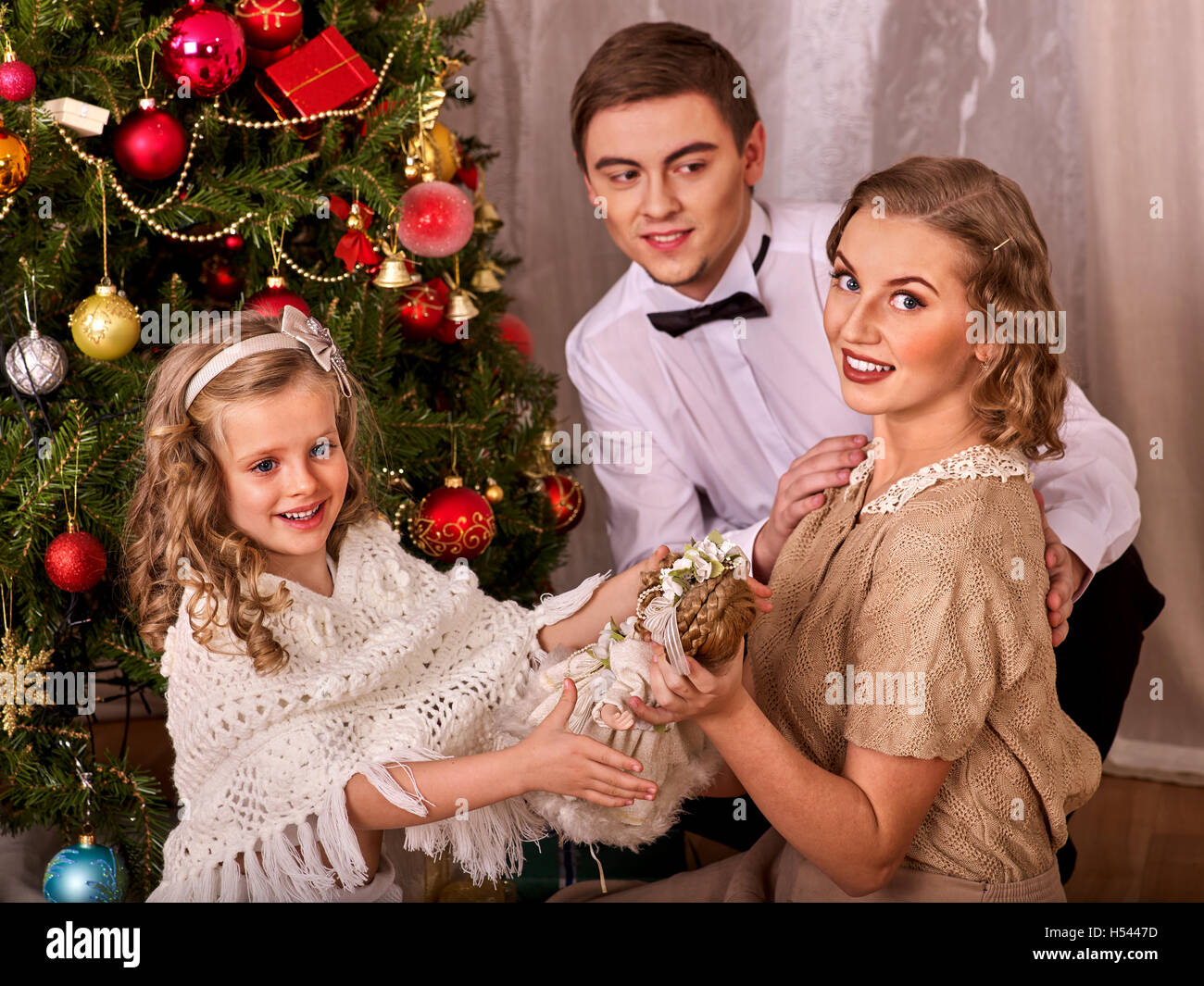 Family with children dressing Christmas tree Stock Photo, Royalty ...