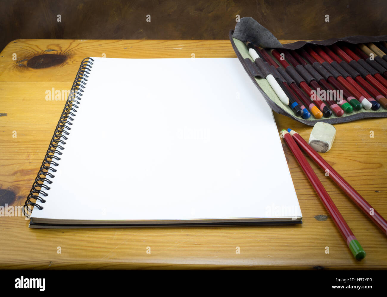 blank art paper drawing pad with pencils folder and eraser on wood stock photo royalty free. Black Bedroom Furniture Sets. Home Design Ideas