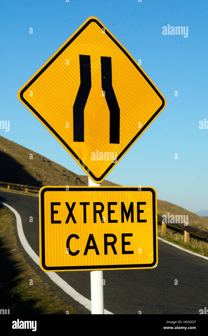Winding road with road narrows and extreme care road signs te winding road with road narrows and extreme care road signs te mata peak hastings hawke bay north island new zealand publicscrutiny Images