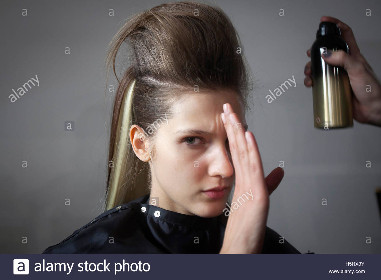 A Model Prevents Hairspray From Being Sprayed Into Her Eyes Backstage  Before The Blonds 2015 Collection