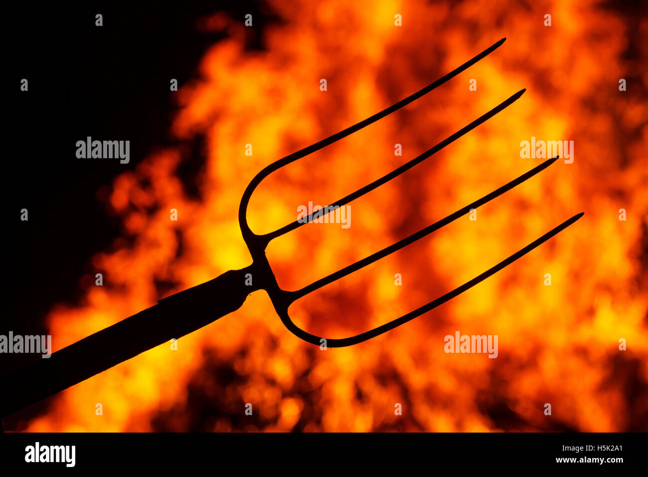 Hell fork on the background of fire stock photo royalty free hell fork on the background of fire voltagebd Choice Image
