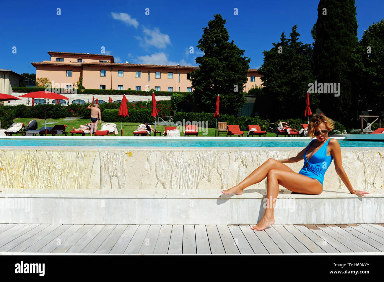 a young woman relaxing at the fonteverde natural spa resort in san casciano dei bagni near siena italy