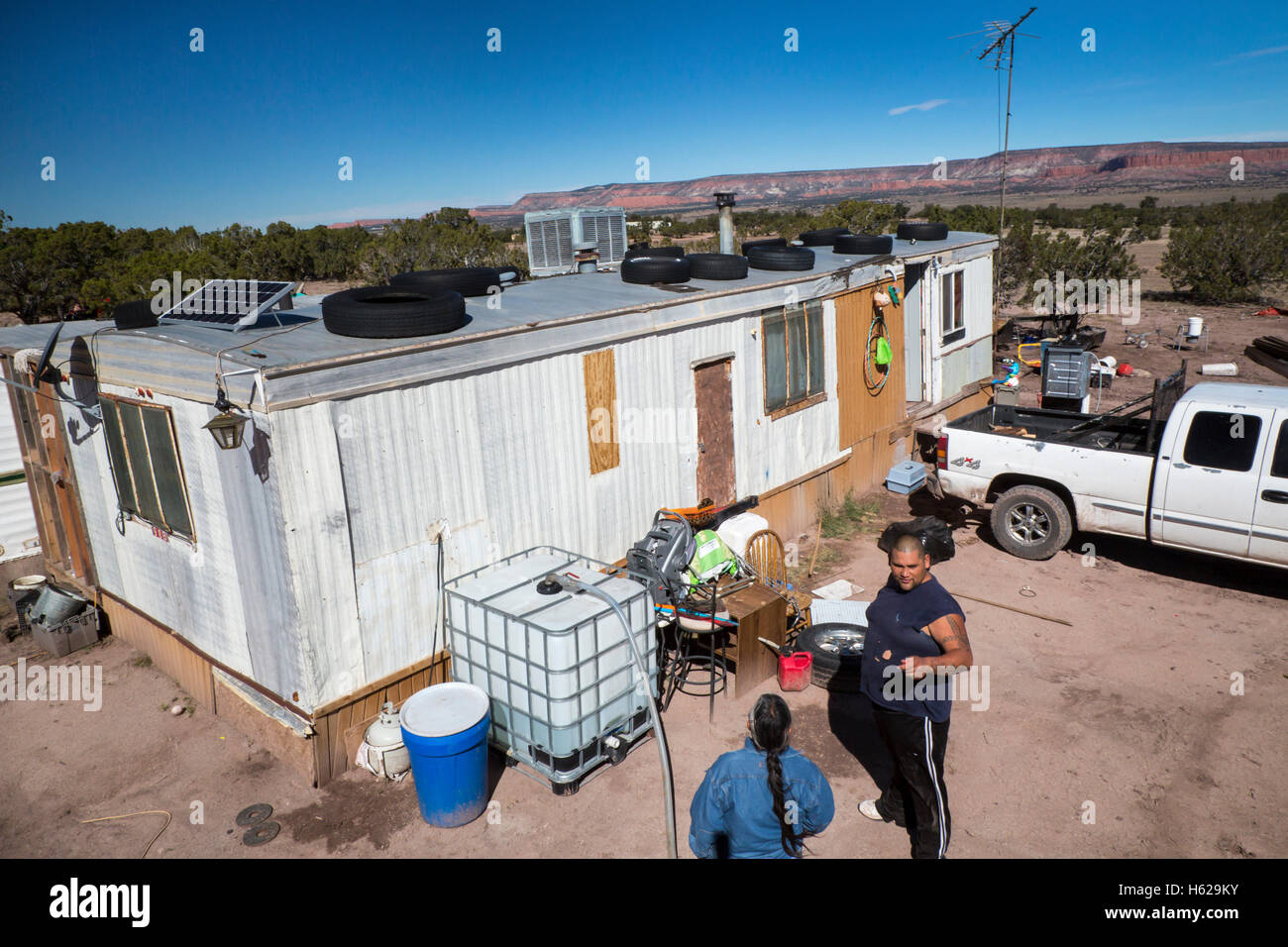 Stock photo thoreau new mexico darlene arviso of st bonaventure indian mission delivers water to a navajo family without a water supply