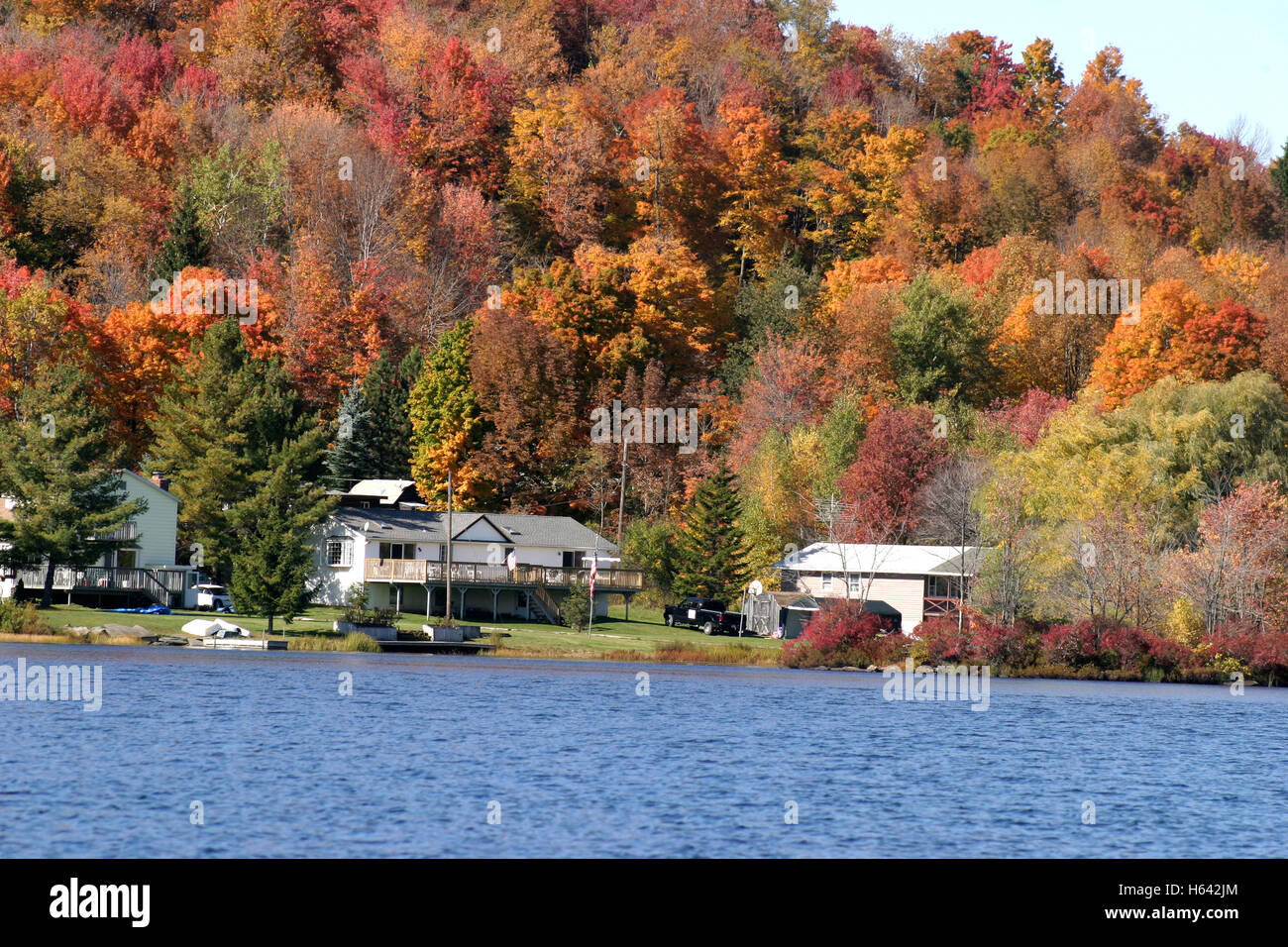 Houses by the lake in upstate new york in autumn with for Lake house upstate ny