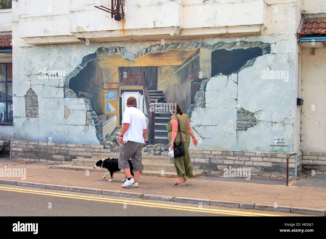 couple walking past trompe l 39 oeil effect mural art painting on the stock photo 124275481 alamy. Black Bedroom Furniture Sets. Home Design Ideas