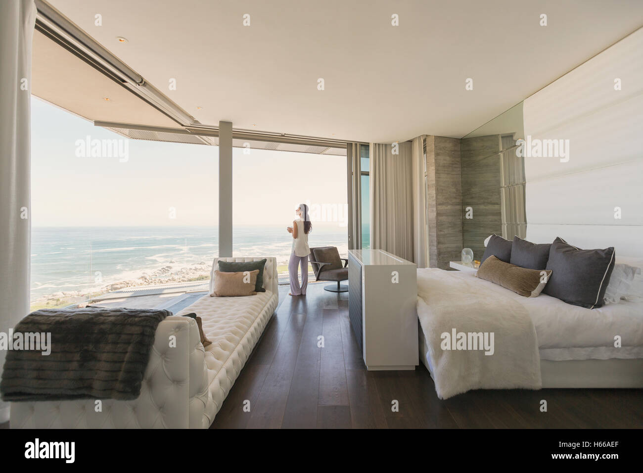 Modern Luxury Bedrooms Woman Looking At Ocean View From Modern Luxury Home Showcase