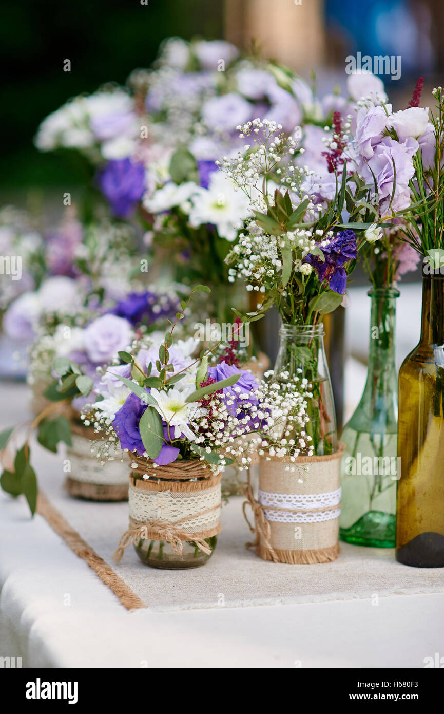 Rustic wedding decor provence style lavender bouquet of field rustic wedding decor provence style lavender bouquet of field flowers and glass spice jars on wooden table junglespirit Choice Image